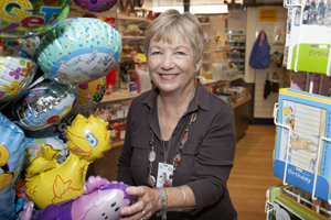 A volunteer lady working at the gift shop